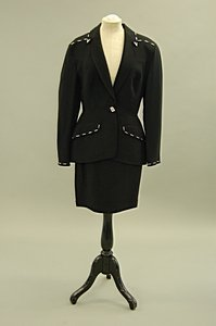 2009: A Thierry Mugler fitted black suit with studded m