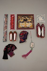 2015: A group of Chinese embroideries and accessories,