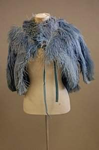 A blue ostrich feather capelet, 1930s, together w