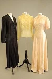 A Norman Hartnell black satin evening suit, circa
