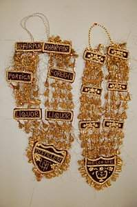 Six Indian tinsel and sequined welcome garlands,
