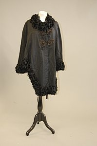 1010: A black silk faille dolman cape, circa 1885, with