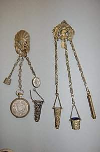 Two pierced gilt metal chatelaines, late 19th cen