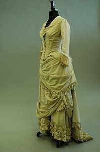 1097: A pink silk ball gown, early-mid 1880s, with two