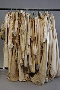 1220: A large group of mainly bridal wear, 1880s-1910s,