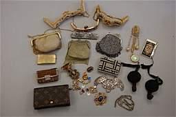 1235: A group of handbag mounts, purses and costume jew