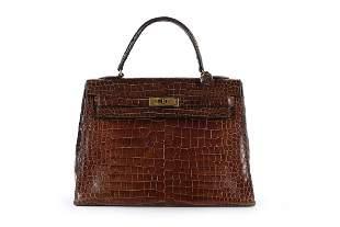 An Hermès brown crocodile Kelly bag, 1962, crocodylus
