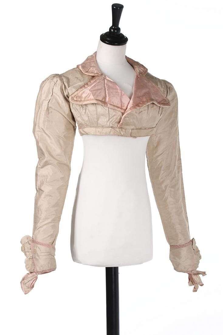 A rare beige and pink silk spencer, 1810-20, with