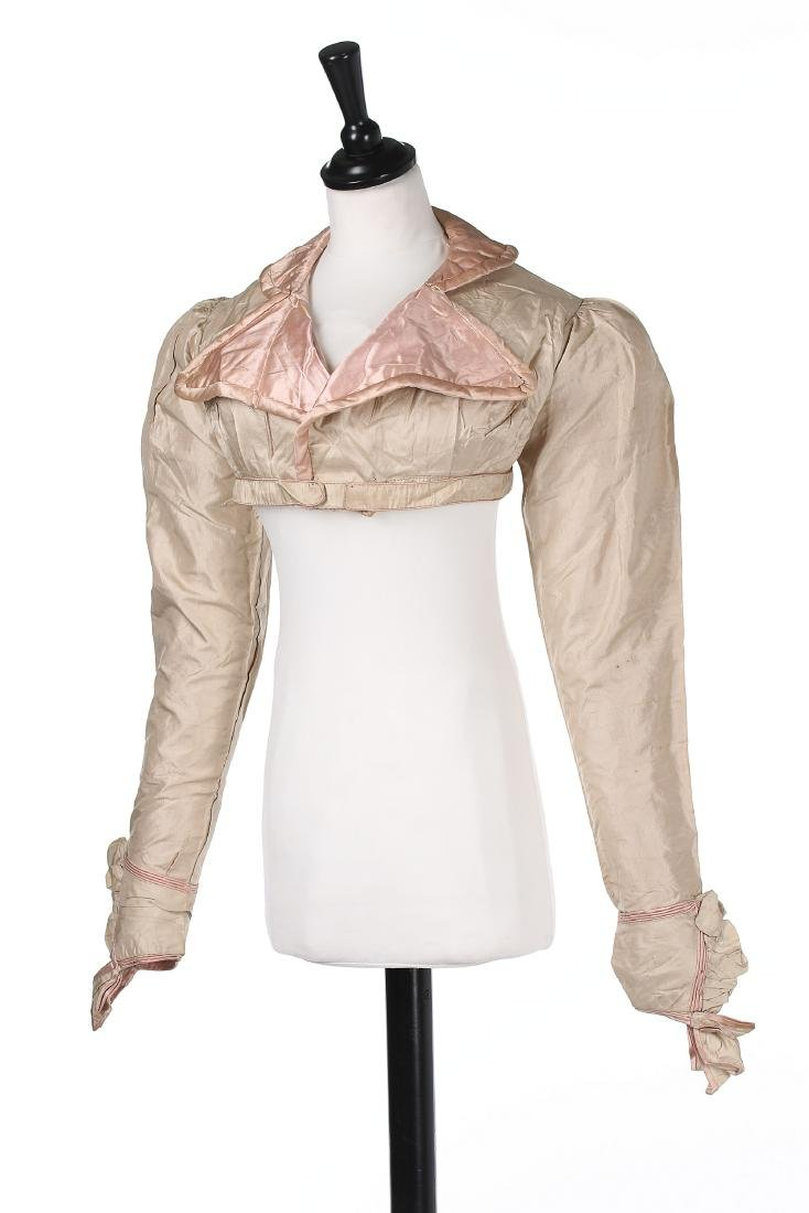 A rare beige and pink silk spencer, 1810-20, with - 2