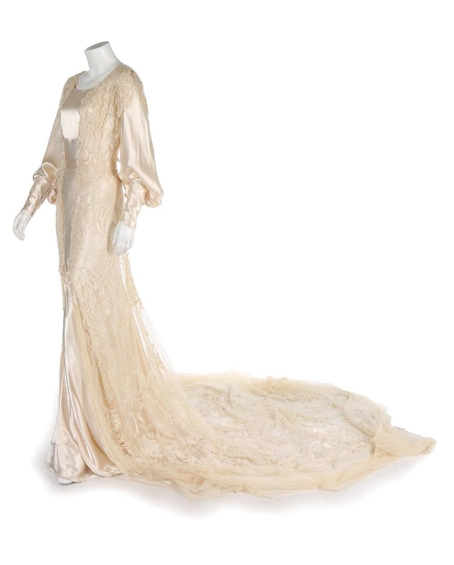 A bias-cut satin bridal gown, 1930s, with full, long
