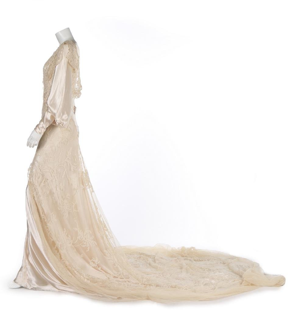 A bias-cut satin bridal gown, 1930s, with full, long - 2