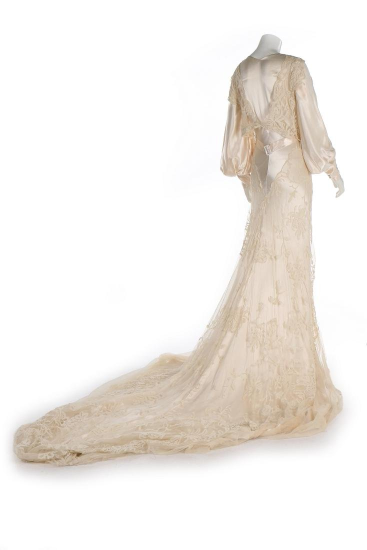 A bias-cut satin bridal gown, 1930s, with full, long - 3