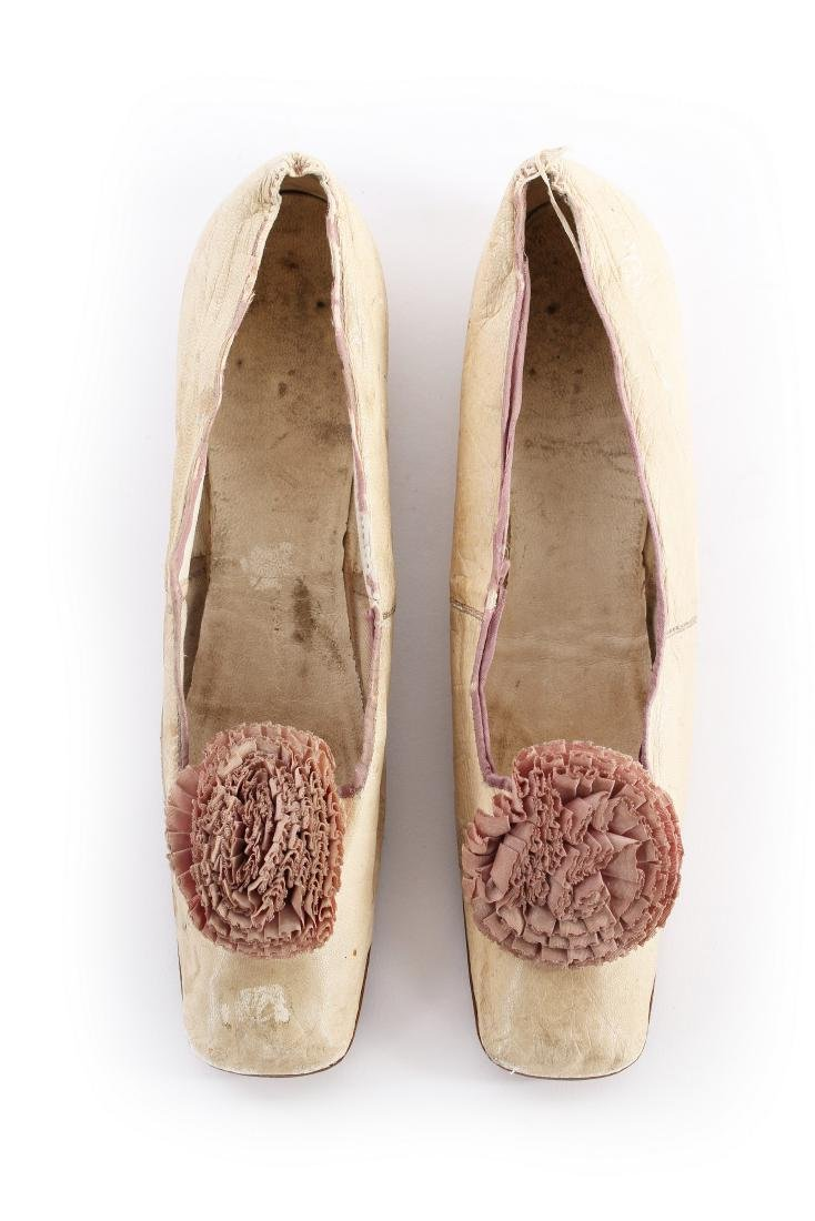 Empress Eugenie's ivory leather pumps, 1860s, with