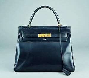 An Hermès navy leather Kelly bag, 1960s, one gilt br