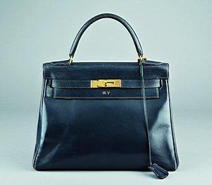 1: An Hermès navy leather Kelly bag, 1960s, one gilt br