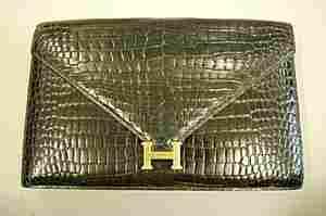 An Hermès black crocodile clutch/shoulder bag, Frenc