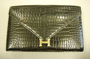 2: An Hermès black crocodile clutch/shoulder bag, Frenc