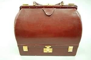 An Hermès burgundy leather Malette, probably 1960s,