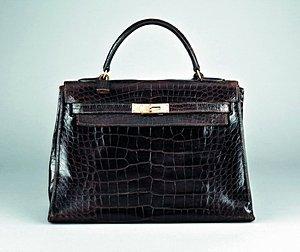 5: An Hermès chocolate brown crocodile leather Kelly ba