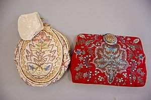 Two evening bags, 1930s, the first of red silk paint