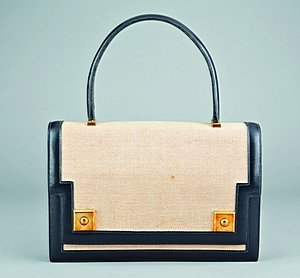 9: An Hermès canvas and black leather  `Piano' handbag,