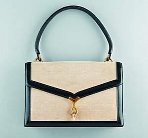 An Hermès tan canvas and black leather handbag, cir