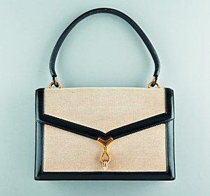 12: An Hermès tan canvas and black leather handbag, cir