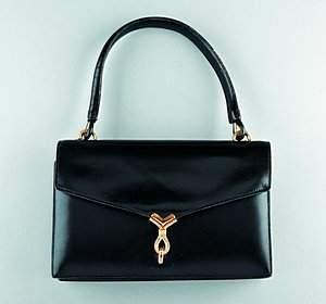 An Hermès black leather handbag, circa 1960-70, sta