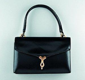 15: An Hermès black leather handbag, circa 1960-70, sta