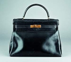 An Hermès `soft' black leather Kelly bag, 1960s, wi
