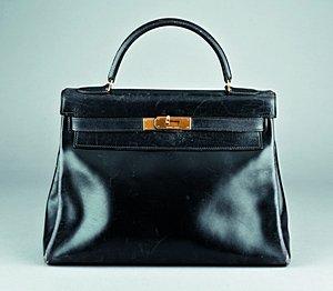 17: An Hermès `soft' black leather Kelly bag, 1960s, wi