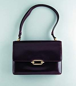 An Hermès burgundy leather handbag, circa 1960, sta