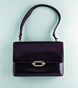 18: An Hermès burgundy leather handbag, circa 1960, sta