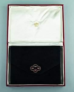 A Cartier black suede pochette, circa 1930, the int