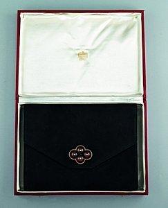 21: A Cartier black suede pochette, circa 1930, the int