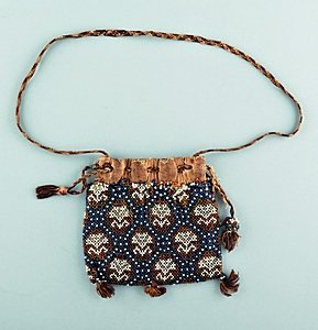 23: A beadworked bag, English, circa 1630, worked with