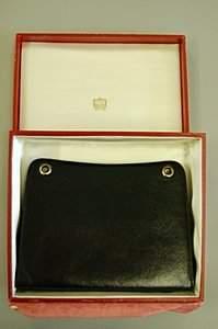 A Cartier Ltd, London black pin-wheel leather clutc