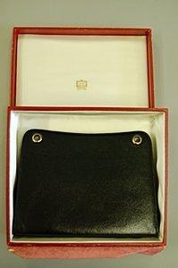 24: A Cartier Ltd, London black pin-wheel leather clutc