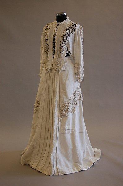 1002: A summer ensemble,  comprising: white linen boler
