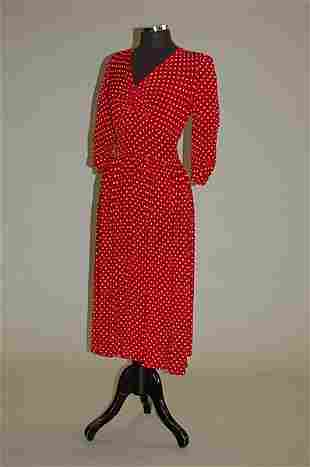 1003: Eight 1940s rayon and silk blouses and a polka do