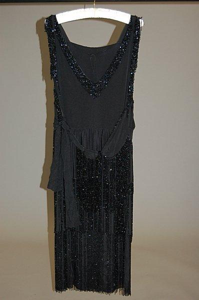 1005: A beaded and fringed flapper dress, circa 1925, o
