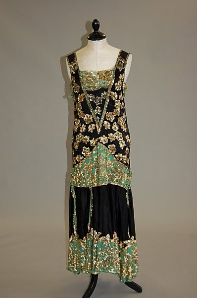 1013: A black satin and green crepe flapper dress, late