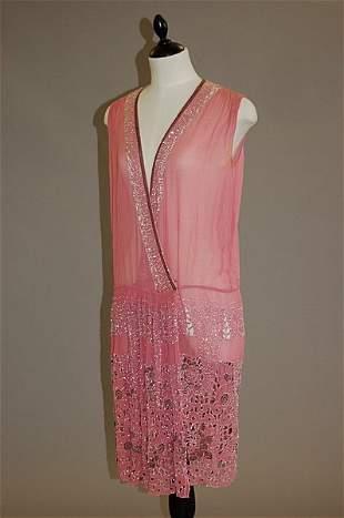 1014: A pink georgette pearl beaded flapper dress, circ