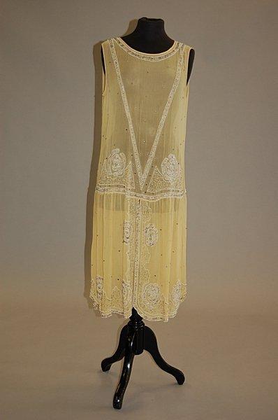 1016: A pale primrose georgette flapper dress, circa 19