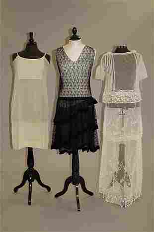 1017: A group of clothing, comprising: black silk faill