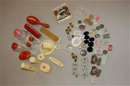 1107: A group of toilet accessories, buckles, costume j