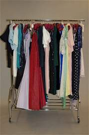 1140: A rail of cocktail dresses, bodices and skirts, 1