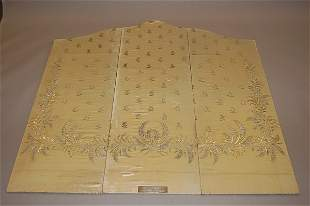 Three screen panels covered in satin taken from a