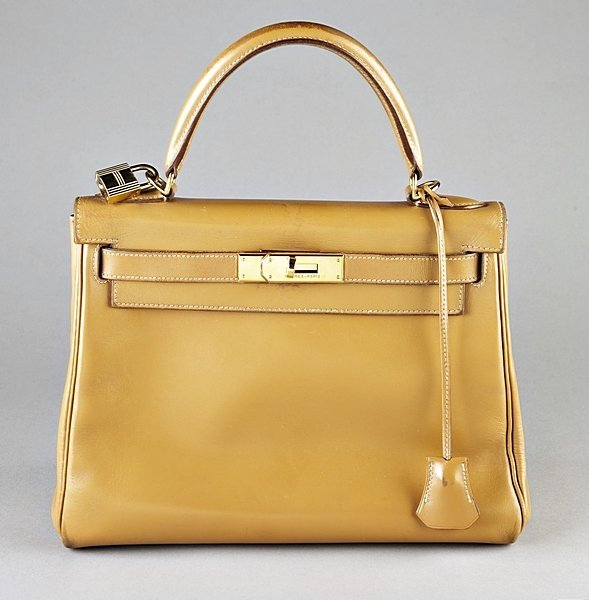 7: An Hermes tan leather Kelly bag, modern, with gilt b