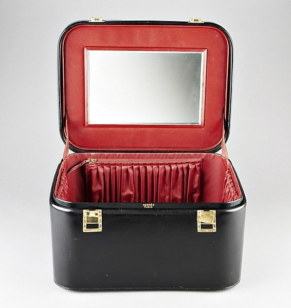 11: An Hermès black leather vanity case, 1960s, with gi